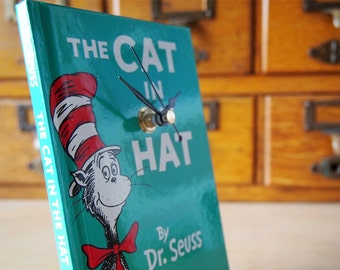 The Cat In The Hat Dr Seuss book clock.  Wall hanging clock created from an original copy of The Cat In The Hat.