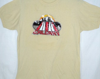 Vintage Calgary tee shirt, size small, yellow, short sleeved, heat transfer image