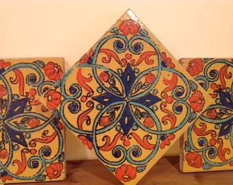"Three 6"" Terra Cotta Floral Tiles"