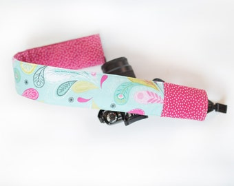 camera strap cover.  feathers and polka dots.