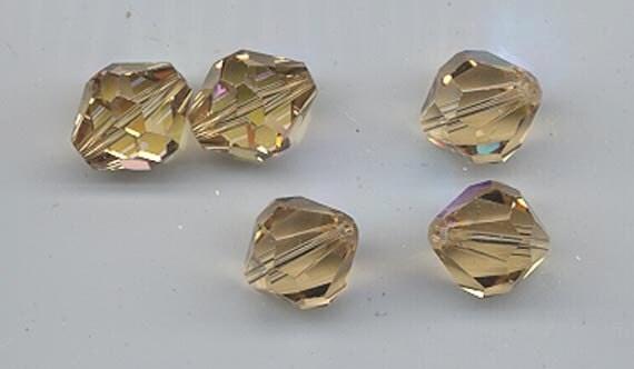 Six vintage Swarovski crystal beads: Art. 5304 - 12 mm - ceylon topaz AB