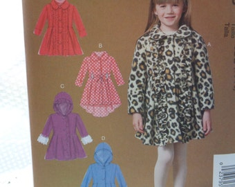 Childs Girls Coat Sewing Pattern McCalls M7013 Hood Peter Pan Collar Belt Button Front Flared Skirt Asymmetrical Hem