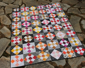 Colorful Lap Size Scrap Quilt in Red Yellow Orange Black White