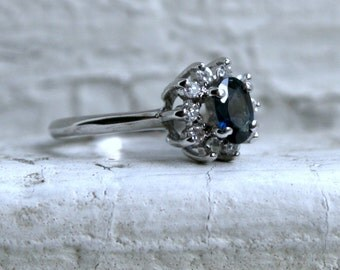 Vintage 14K White Gold Diamond Halo and Sapphire Engagement Ring - 0.70ct.
