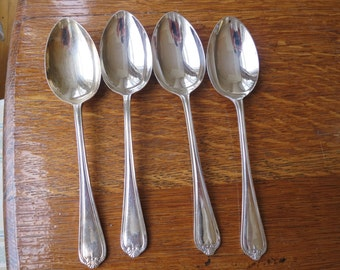 Set f 4 large silver plated serving spoons