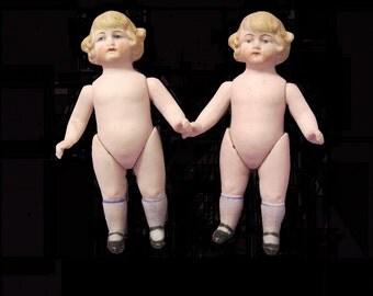Antique Twin Bisque Dolls