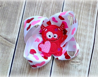 Love Monster Boutique Bow Valentines Day Monster Love attached to an alligator clip!