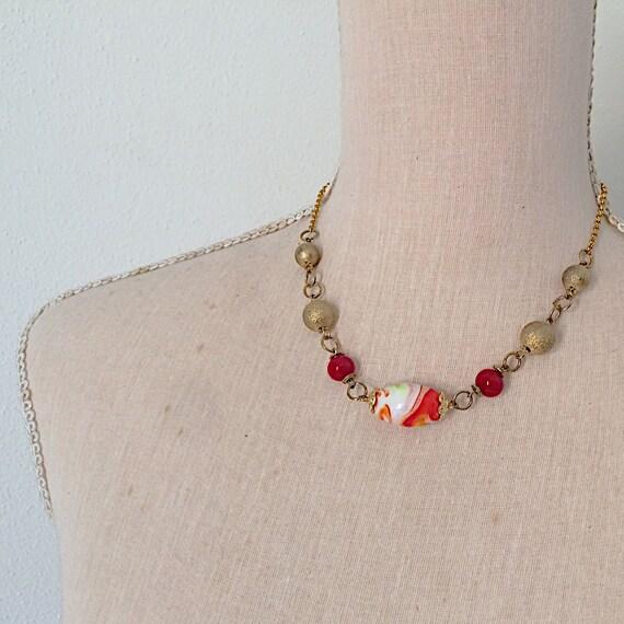 golden orange red handblown glass necklace