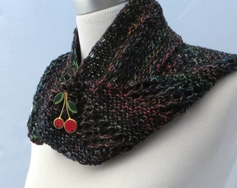 Hand knit shawlette in black with a rainbow