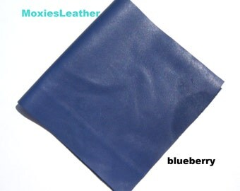 medium blue leather piece , blueberry leather , soft leather piece . leather for art project