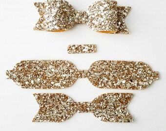 Die Cut Bows- pack of 5- unassembled. Gold Glitter Fabric die cut bows, Bow making supplies, Glitter Fabric, craft Supplies.