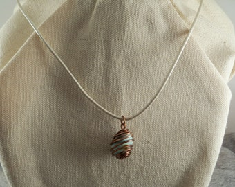Wire-Wrapped turquoise nugget Pendant on a white leather cord