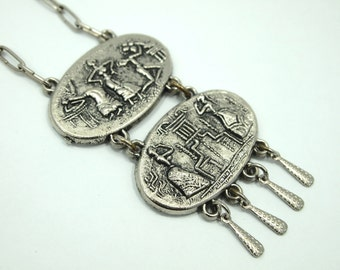 """Vintage Necklace - Ethnic / Tribal Base Relief Scenes - Aged Patina - Silver Plated Metal - 29"""" chain 3.25"""" Double Pendant & Dangles"""