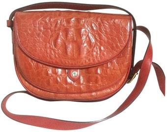 90s Vintage Etienne Aigner alligator embossed leather shoulder purse. Stunning color of deep orange