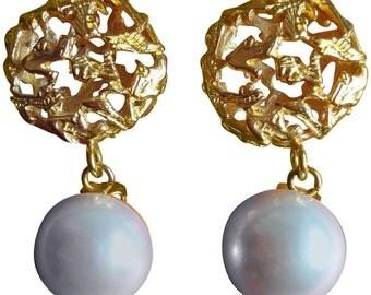 Vintage Salvatore Ferragamo white faux pearl earrings with golden shoe design featured charm. Ferragamo dangling earrings.