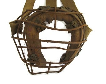 vintage catcher's mask from the 1930's