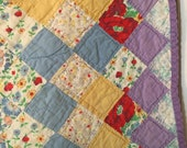 RESERVED   Vintage quilt, colorful feedsack, lavender pastel beautiful hand quilted.  This is a nice light-weight quilt.