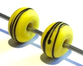 Lampwork glass etched earring pair in a springlike yellow with fine black lines