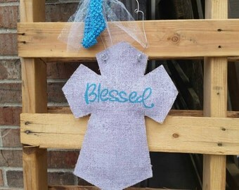"Burlap cross with painted ""blessed"" message"