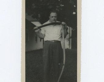 Vintage Snapshot Photo: Creepy Guy with Scythe, 1940s-50s (69504)