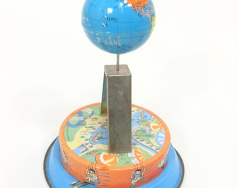 Wind Up Tin Toy Spinning Globe, Made In China