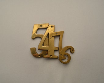 Vintage brass numbers