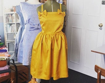 Fabulous party dress in gold mustard yellow vintage fabric. Great for evening this cocktail dress is a UK size 20 US size 16