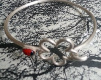 Handmade silver bracelet with flower and ladybug