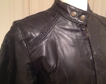 Leather motorcycle jacket, Vintage 70s / genuine black leather patchwork design / women's jacket size Medium / GREAT CONDITION