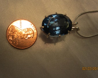Oval Blue Topaz Pendant