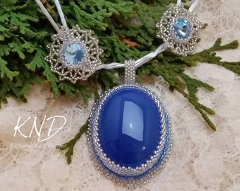 Frozen inspired snow flake necklace and earring set, blue chalcedony, blue topaz, swarovski crystals.