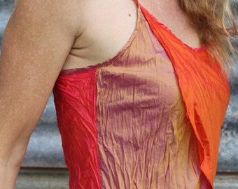 Orange, toffeee and firefly red in slinky silk. Cami, singlet. Adjustable straps, with a flattering cut. S,M and L available