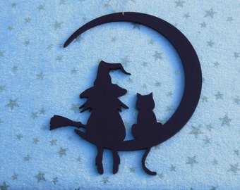 The witch and his cat , wooden cut