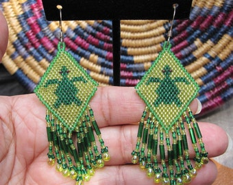 Native American style beaded turtle earrings in greens with beaded drop fringe