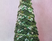 Folded fabric quilted tabletop tree, Christmas decoration, fabric with leaf design, green ric rac trim, colored sequins, gold and green bow