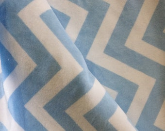 A lovey blanket in chevron print in blue and white minky blanket . The chevron is shannon brand