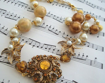 Vintage statement necklace, assemblage, repurposed brooch in amber, gold, ivory pearls