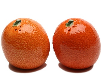 "Pair of Oranges Salt and Pepper Shaker Set 2.25"" long 2.55"" tall"
