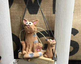 Frame with terracotta cat and mouse