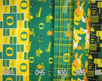 NCAA University of Oregon Ducks Green & Yellow College Logo Cotton Fabric by Sykel! [Choose Your Cut Size]
