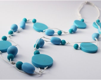 Light Blue Resin Bead Necklace White Waxed Cotton