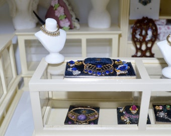 Dollhouse miniature jewelry box with jewelry for minaiture shop