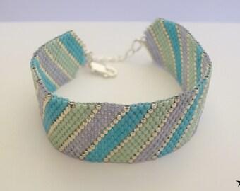 Bracelet woven with needle, beads Miyuki silver, light green pastel, purple transparent / women gift