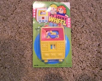 Vintage Play n Fun TV Lucky Wheel Made in Hong Kong Twist Toy No. 824 in original packaging