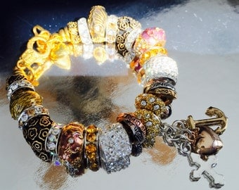 Gold, rose, and crystal European bracelet.