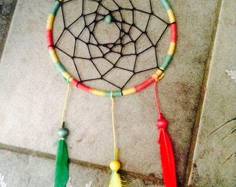 Rasta red, green, yellow feather beaded dreamcatcher