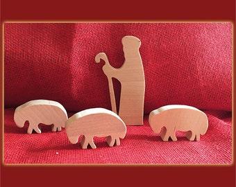 Shepherd and three sheep Nativity figures