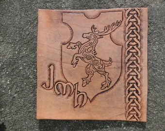 Custom leather carving of stag on shield with personalized monogram