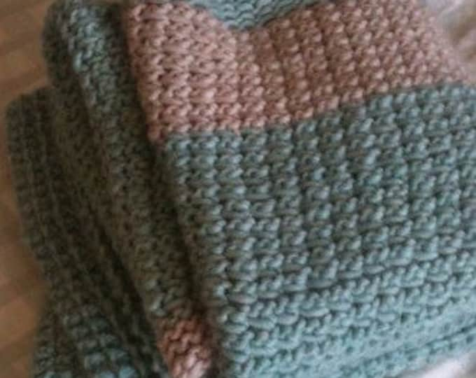 Soft green and oatmeal colored knit wool throw