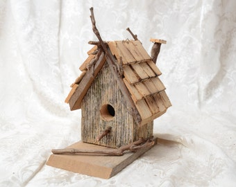Rustic Primitive Bird House made from reclaimed barn lumber.